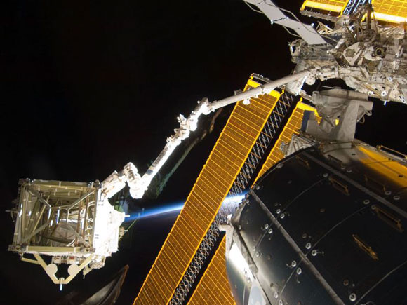 STS-119 arm holds array