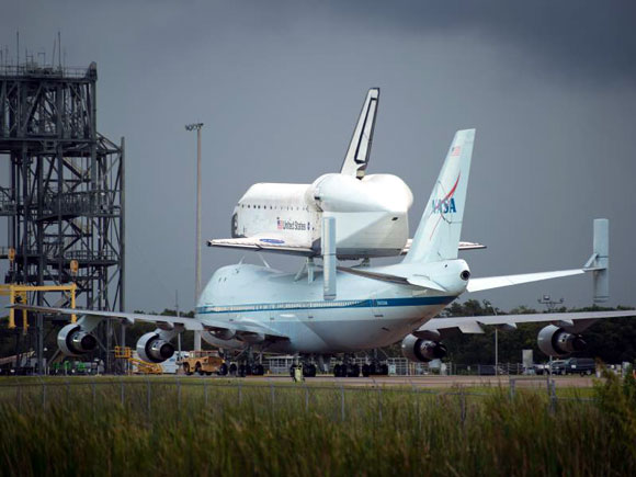 Space shuttle Endeavour is seen atop Carrier Aircraft at NASA's Kennedy Space Center, FL. 09-17-2012