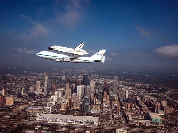 Space Shuttle Endeavour is ferried by Carrier Aircraft over Houston, Texas 09-19-2012